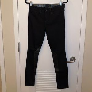 Black jeans with leather detail